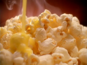 buttered popcorn. - popcorn stock videos & royalty-free footage