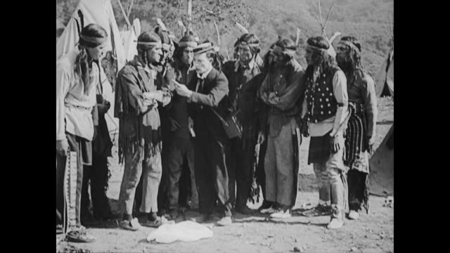 1922 Butterfly hunter (Buster Keaton) catches bee on American Indian reservation
