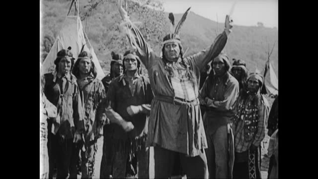 1922 Butterfly hunter (Buster Keaton) enters American Indian reservation