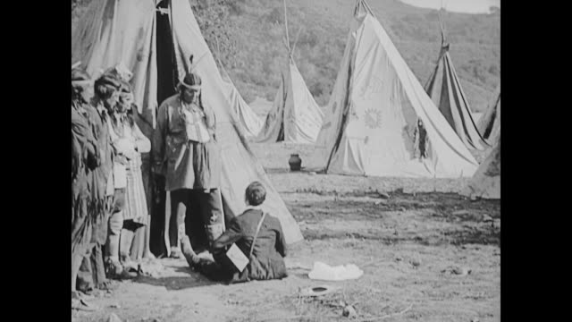 1922 Butterfly hunter (Buster Keaton) tries to follow squaw (Virginia Fox) into her teepee