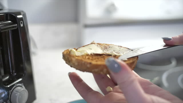 buttering a bagel - cheese stock videos & royalty-free footage