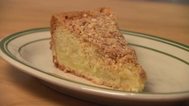 buttery basque cake with crushed almond crust at mfk. restaurant in chicago on nov. 12, 2014. - basco video stock e b–roll