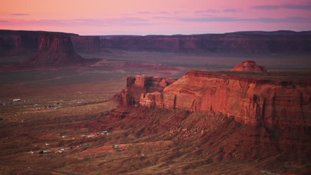 aerial buttes in monument valley at sunrise - monument valley stock videos & royalty-free footage