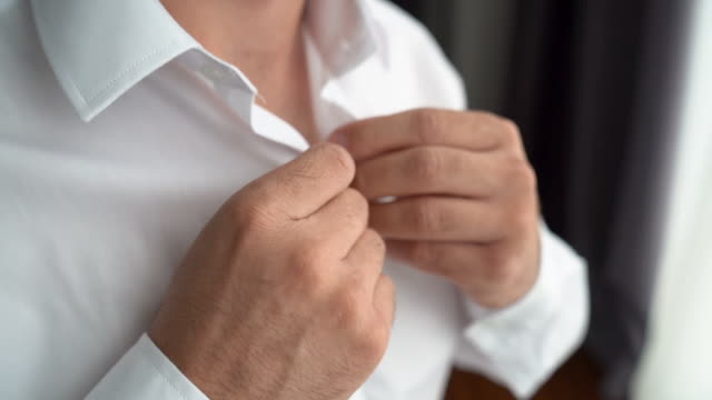 buttoning the shirt - shirt stock videos & royalty-free footage