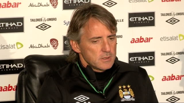 buying and selling on last day of transfer window manchester etihad stadium int roberto mancini press conference sot i think if we close these... - transfer stock videos and b-roll footage