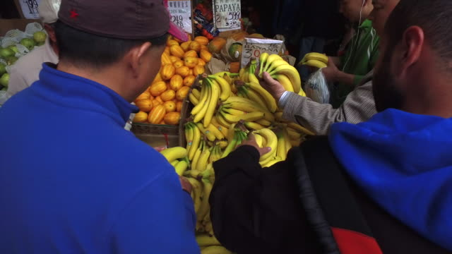 Buying Banana at Chinese Food Grocery Store in Flushing Chinatown, New York