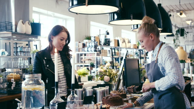 buying cake in a nice modern cafe (slow motion) - bakery stock videos and b-roll footage