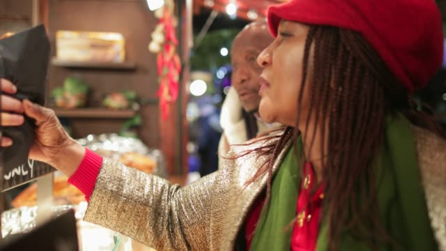 buying christmas market fast food - christmas market stock videos & royalty-free footage