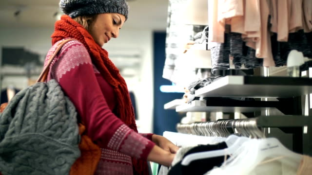 buying clothes at retail store. - matching outfits stock videos & royalty-free footage