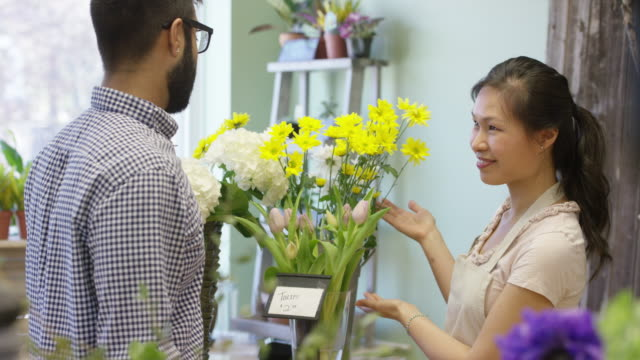 buying flowers for someone special - retail occupation stock videos & royalty-free footage