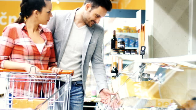 buying food in supermarket - shopping basket stock videos and b-roll footage