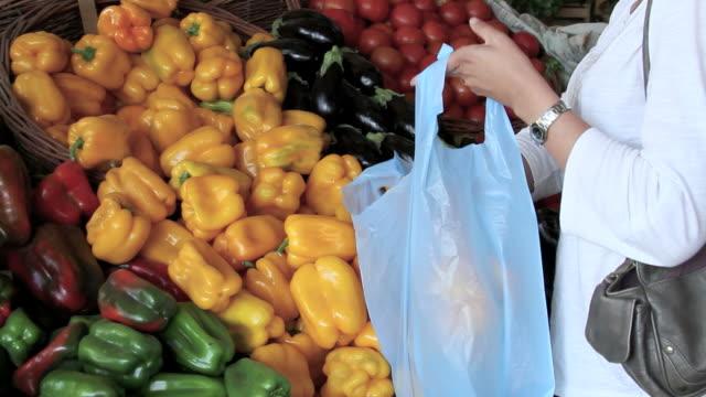 buying fresh paprika - plastic bag stock videos & royalty-free footage