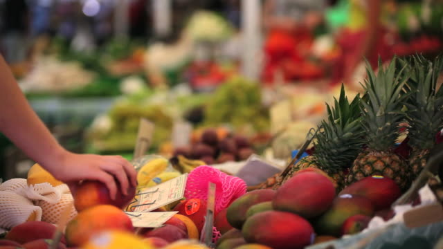 buying fruits at the open market close-up - frische stock videos & royalty-free footage