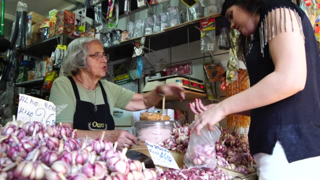 buying on small business garlic shop - bancarella video stock e b–roll