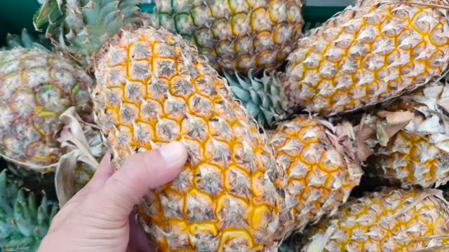 buying pineapple at supermarket - crate stock videos & royalty-free footage