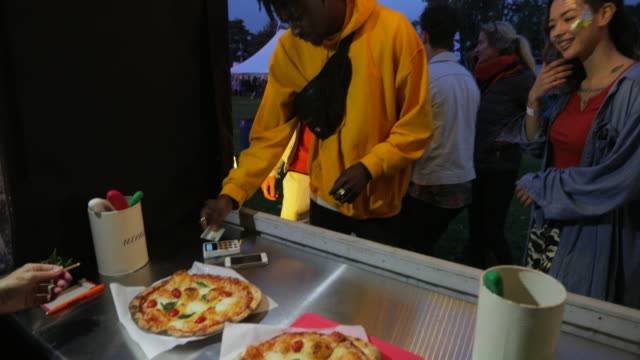 buying pizza at a festival - margherita video stock e b–roll