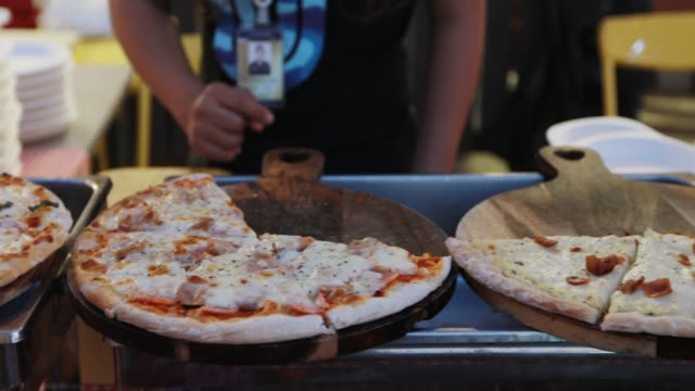 buying pizza at a festival - cafeteria stock videos & royalty-free footage