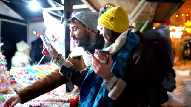 buying some candy at christmas market. - spending money stock videos & royalty-free footage