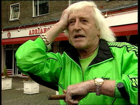 yorks leeds sir jimmy saville intvwd talks about the joy of owning a rolls royce london i/c - ジミー サヴィル点の映像素材/bロール