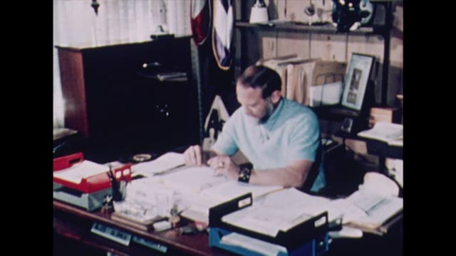 "buzz aldrin sits at his desk in solitude, writing his book ""return to earth"". - author stock videos & royalty-free footage"