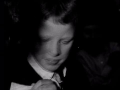 b/w 1960s footage Schoolboy receiving smallpox vaccination MS Nurse injecting arm Schoolchild receiving vaccination