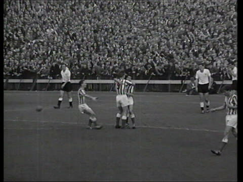 b/w footage showing brian clough scoring a goal for middlesbrough and then collapsing on the ground after injuring his knee lib hartlepool: b/w... - b rolle stock-videos und b-roll-filmmaterial