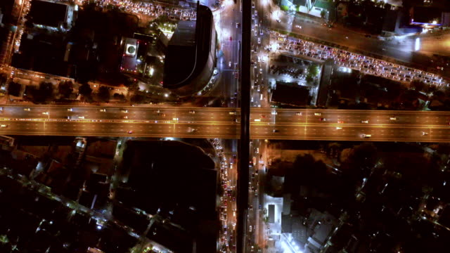 aerial by drone, ws aerial shot of highway with traffic at night/bangkok, thailand - leicester stock videos & royalty-free footage