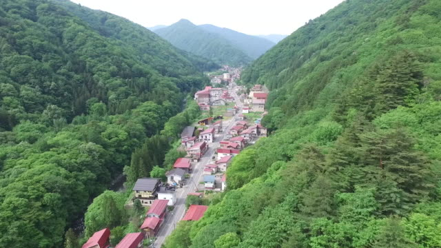 aerial by drone, village in green valley, fukushima, japan - satoyama scenery stock videos & royalty-free footage