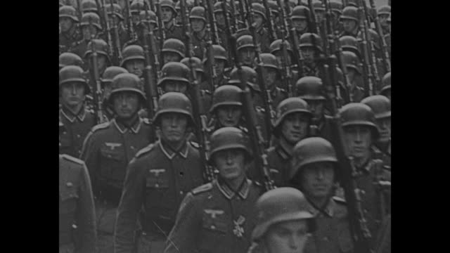 vídeos de stock, filmes e b-roll de by normandy shore, probably german troops marching in front of lookout bunker, can see arms holding binoculars / side view of soldier looking through... - adolf hitler