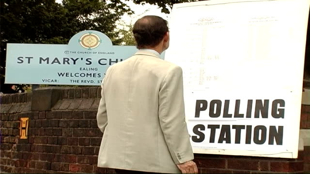 polling day england london ealing ext voters into polling station to vote in the ealing southall byelection man looking at list of candidates... - polling place stock videos & royalty-free footage