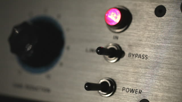 Bypass button on a sound console