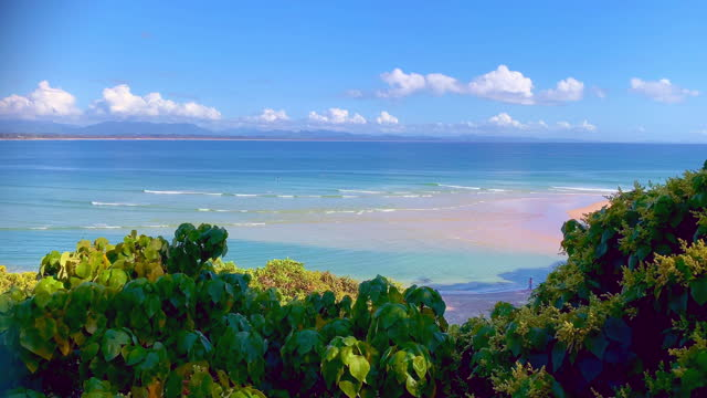 byron bay surf and blue sky - surfing stock videos & royalty-free footage