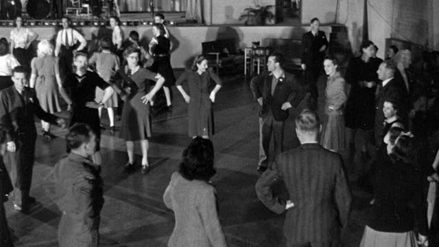 1945 montage bystander observing couples dancing the hokey cokey in recreation lounge / coventry, west midlands, england - coventry stock videos & royalty-free footage