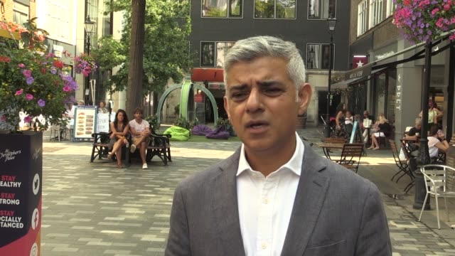 bystander who identifies himself as a taxi driver but would not give his name heckles london mayor sadiq khan, blaming him for stifling business in... - incidental people stock videos & royalty-free footage