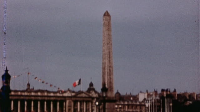 bystanders and parade at avenue des champs elysee on ve day / paris france - ve day stock-videos und b-roll-filmmaterial