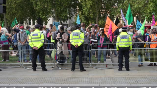 bystanders and press observe an extinction rebellion protest on september 10 in london, england. extinction rebellion activists are holding ten days... - incidental people stock videos & royalty-free footage