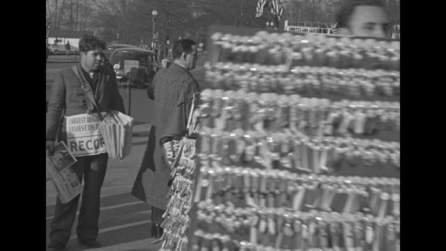 bystanders at parade route / people at rope line huddled against the cold cheerful cold policeman beats his hands together / vendor walking with... - cordell hull stock videos and b-roll footage