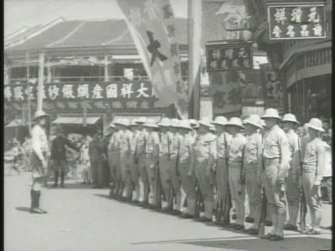china us marines vs united states marines lined during outdoor ceremony drill sergeant calling soldiers at attention marching through crowded street... - united states marine corps stock-videos und b-roll-filmmaterial
