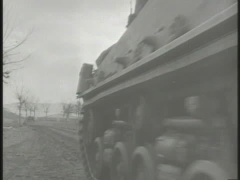stockvideo's en b-roll-footage met korean war us marines vs united states marines riding on top of moving m4 sherman tanks marines climbing hill firing rifles from defensive positions... - pantservoertuig