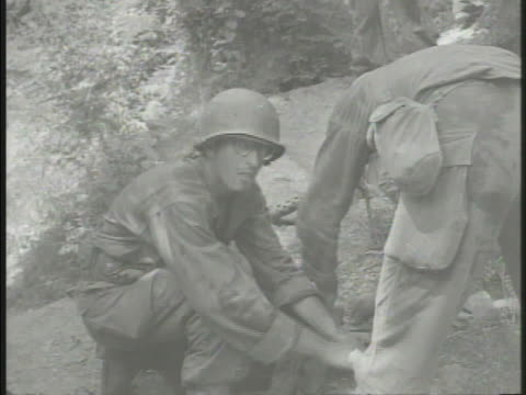 korean war us marines vs various wounded united states marines medics tending body helping soldier walk laying soldier on stretcher group of marines... - parallel stock videos & royalty-free footage