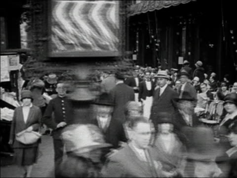ca. 1929 - 1930 b/w ws cs pov people walking on city streets / paris, france - 1930点の映像素材/bロール
