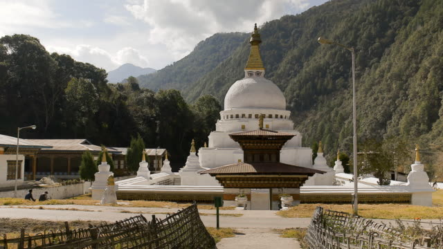 the chorten kora is an important stupa next to the kulong chu river in trashiyangtse, in east bhutan and visited by many buddhist pilgrim - pilgrim stock videos & royalty-free footage