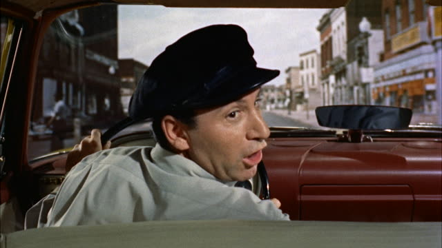 ms pov cab driver as he driving through city street / new york, united  - 1950 stock-videos und b-roll-filmmaterial