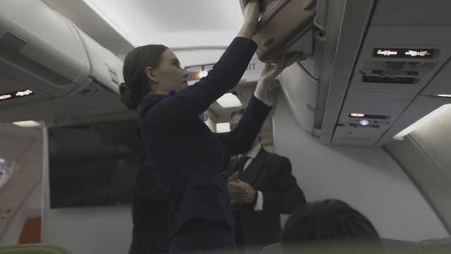 cabin crew or air hostess working in airplane . - crew stock videos & royalty-free footage