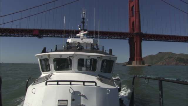 ms, cabin of police motor boat seen from boat deck, golden gate bridge in background, san francisco bay, california, usa - police boat stock videos and b-roll footage