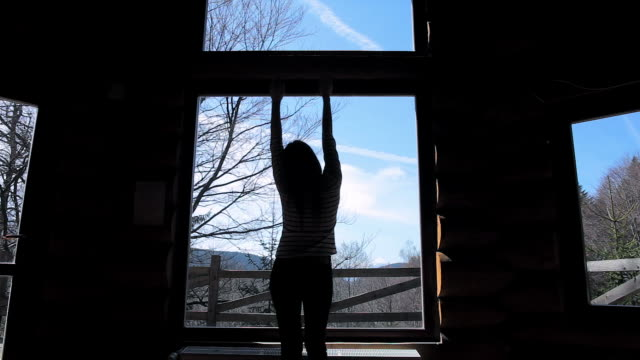 cabin retreat - video of a young woman enjoying a beautiful day. - cottage stock videos & royalty-free footage