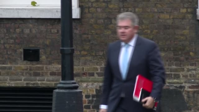 cabinet arrivals and departures at downing street england london downing street ext ministers along to number ten on arrival for cabinet meeting... - liam fox politician stock videos and b-roll footage