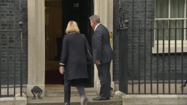 london downing street front door of number 10 / patrick mcloughlin mp arriving / karen bradley mp arriving / priti patel mp arriving past larry the... - michael gove stock-videos und b-roll-filmmaterial