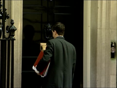cabinet arrivals at downing street; douglas alexander mp along and into house ian mccartney mp chatting to unidentified man then posing for... - ダグラス アレキサンダー点の映像素材/bロール