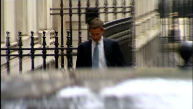 cabinet arrivals at no10 david jones mp arriving jeremy hunt mp arriving vince cable mp arriving theresa villiers mp and david willetts mp arriving... - sir george young politician stock videos and b-roll footage
